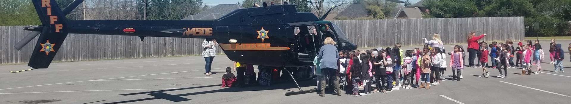 School children getting to look at the Sheriff helicopter