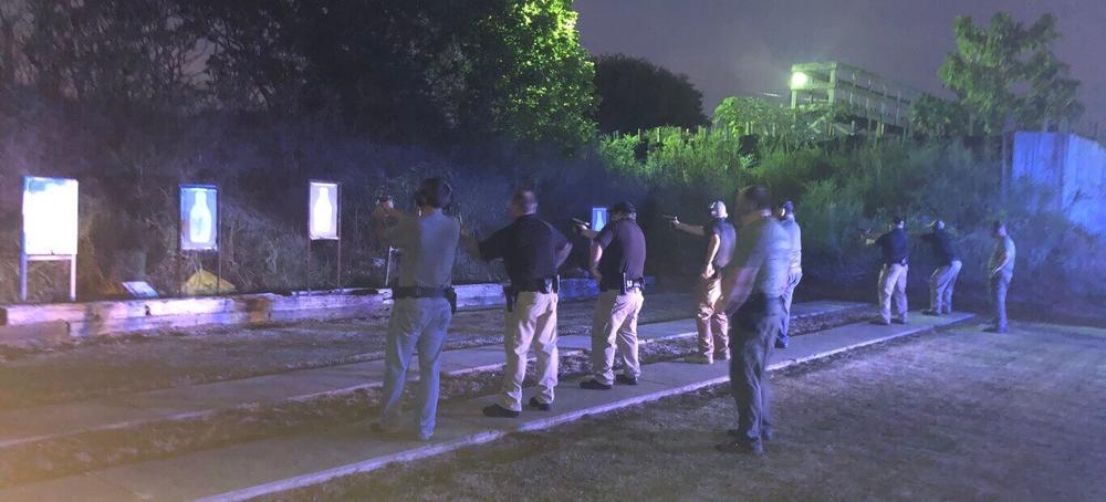 Reserve Deputies at the shooting range at night
